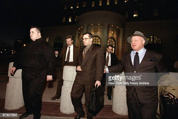 John Gotti Jr leaves White Plains courthouse after pleading guilty to racketeering charges on the eve of his trial Gotti is flanked byt his brother...