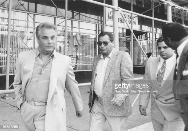 John Gotti leaves Queens Criminal Court with his son John Jr after the latter's acquittal on a charge of assaulting an offduty police officer in a...