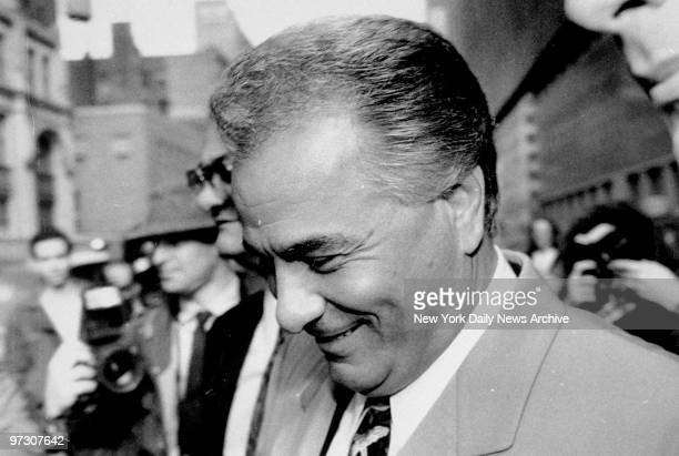 John Gotti smiles outside the court house during a recess from his trial at which he was found not guilty