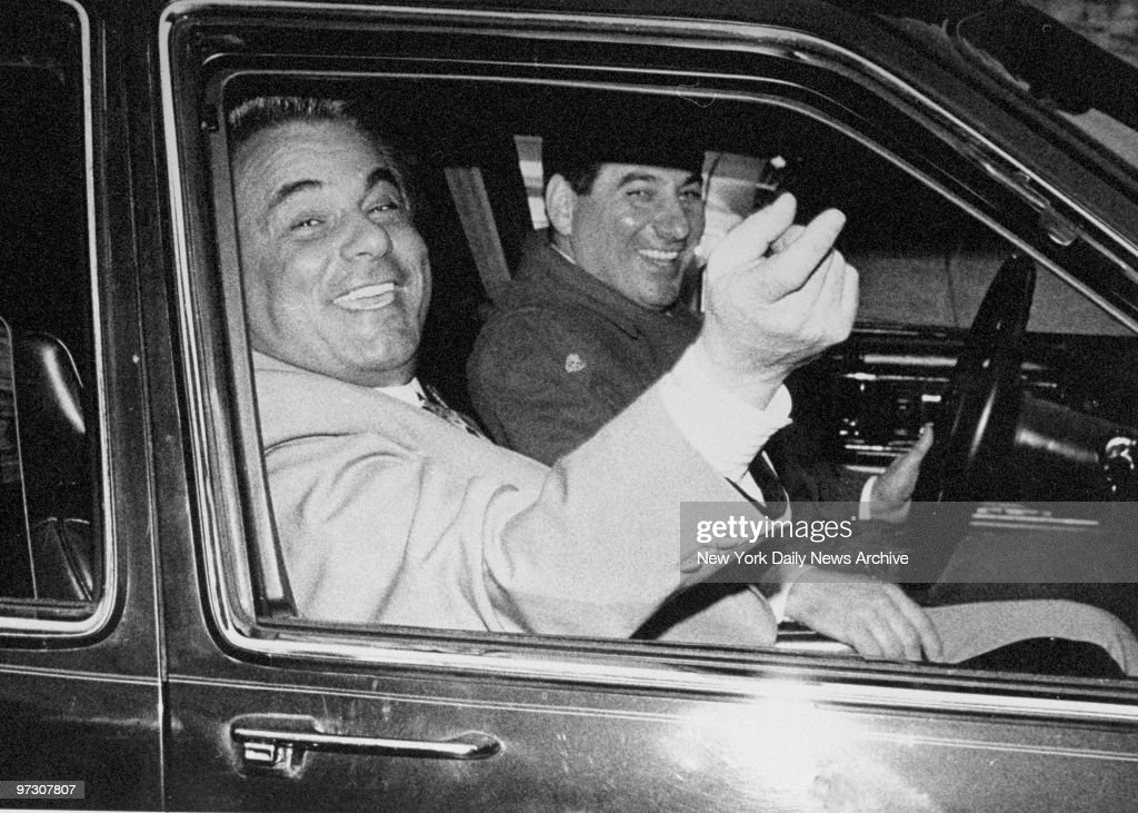 John Gotti, the 'Teflon Don,' is all smiles as he and his driver arrive at the Ravenite Social Club on Mulberry St. after Gotti was acquitted on charges of conspiracy and assault in the 1986 shooting of a carpenter's union official.