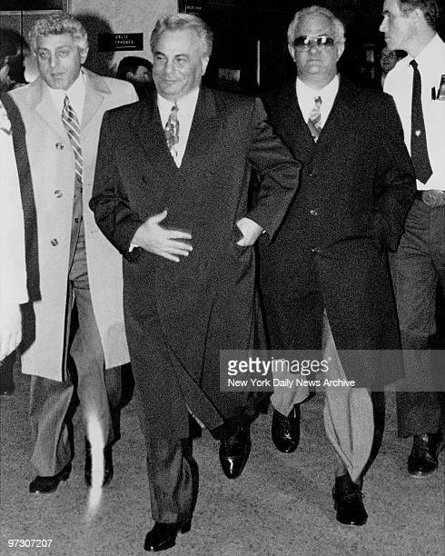 John Gotti with a smile on his face older brother Peter Gotti and John D'Amico leave Manhattan Supreme Court where he is on trial on charges of...