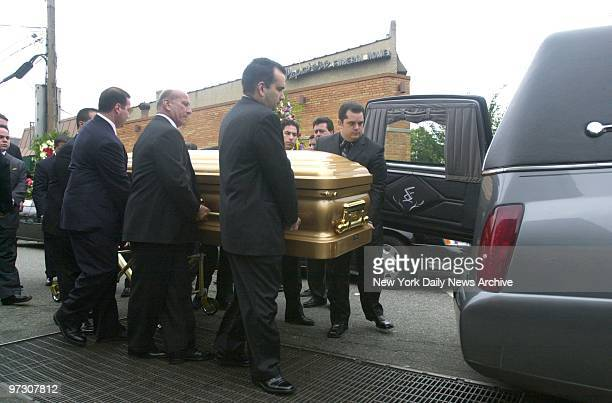John Gotti's coffin is borne to a waiting hearse by his younger brother Richard and other pallbearers outside the Papavero Funeral Home in Maspeth...
