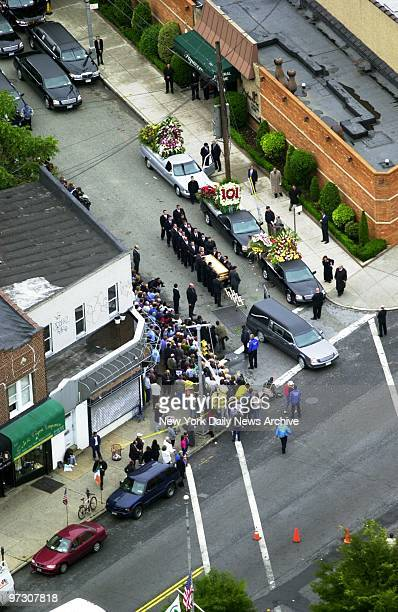 John Gotti's coffin is carried to a waiting hearse by pallbearers outside the Papavero Funeral Home in Maspeth Queens after a funeral service for the...