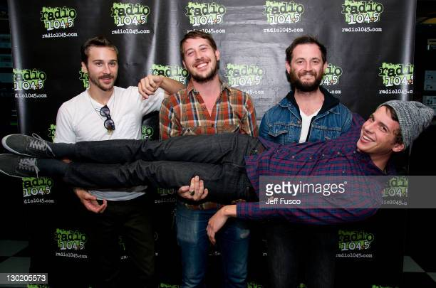 John Gourley Zachary Carothers Jason Sechrist and Ryan Neighbors of Portugal The Man pose at the Radio 1045 Performance Theater on October 24 2011 in...
