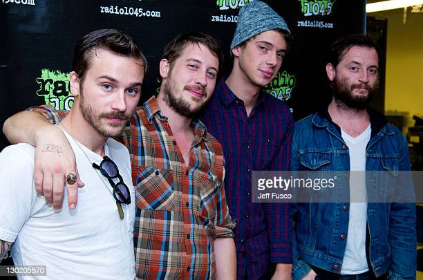 John Gourley Zachary Carothers Ryan Neighbors and Jason Sechrist of Portugal The Man pose at the Radio 1045 Performance Theater on October 24 2011 in...