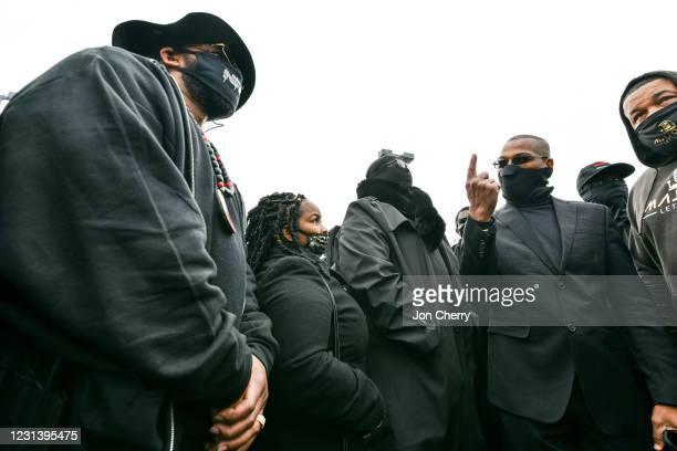 """John """"Grandmaster Jay"""" Johnson, leader of the NFAC, gestures as he speaks with NFAC members in a parking lot in the Old Louisville neighborhood on..."""