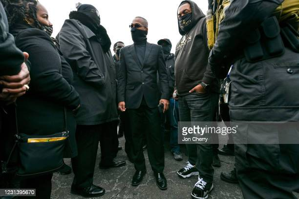 "John ""Grandmaster Jay"" Johnson, leader of the NFAC, speaks with NFAC members in a parking lot in the Old Louisville neighborhood on February 26, 2021..."