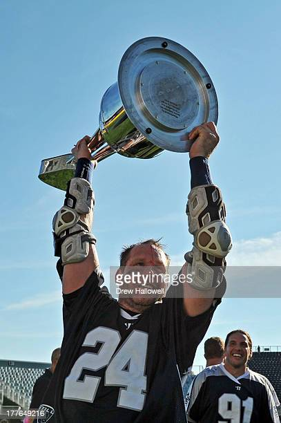 John Grant Jr #24 of the Chesapeake Bayhawks holds the trophy after beating the Charlotte Hounds 109 during the MLL Championship at PPL Park on...