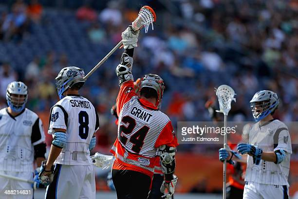 John Grant Jr #24 of the Denver Outlaws celebrates after scoring against the Ohio Machine during the fourth quarter at Sports Authority Field at Mile...