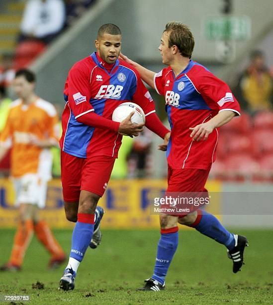John Grant of Aldershot is congratulated on his goal by Ryan Scott during the FA Cup sponsored by EON Third Round match between Blackpool and...