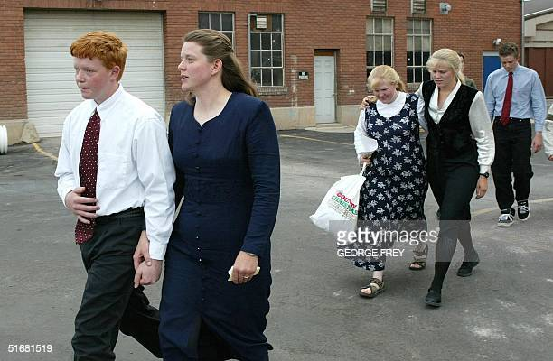 John Green , Linda Green , Cari Green , Hannah Green , and Mel Green , wives and sons of Utah polygamist Tom Green leave court after Tom Green was...