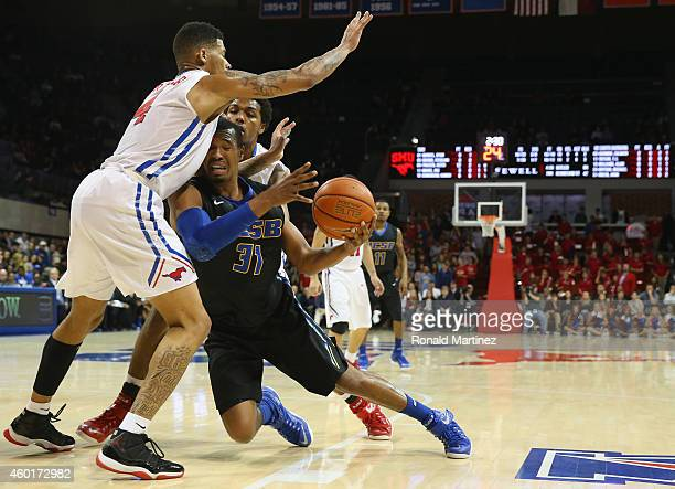 John Green of the UC Santa Barbara Gauchos dribbles the ball against Keith Frazier of the Southern Methodist Mustangs in the first half at Moody...