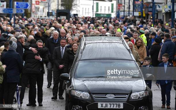 John Gregg is hugged in the street by a well wisher as the funeral of his father and former Manchester United and Northern Ireland footballer Harry...