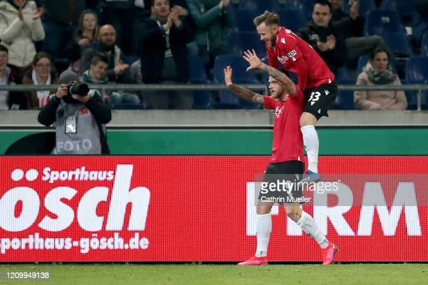 John Guidetti and Cedric Teuchert of Hannover 96 celebrate after scoring during the Second Bundesliga match between Hannover 96 and Holstein Kiel at...