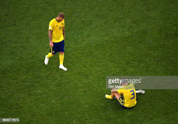John Guidetti and Victor Lindelof of Sweden look dejected following the 2018 FIFA World Cup Russia Quarter Final match between Sweden and England at...