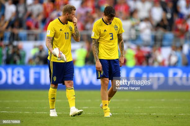 John Guidetti and Victor Lindelof of Sweden show their dejection following the 2018 FIFA World Cup Russia Quarter Final match between Sweden and...