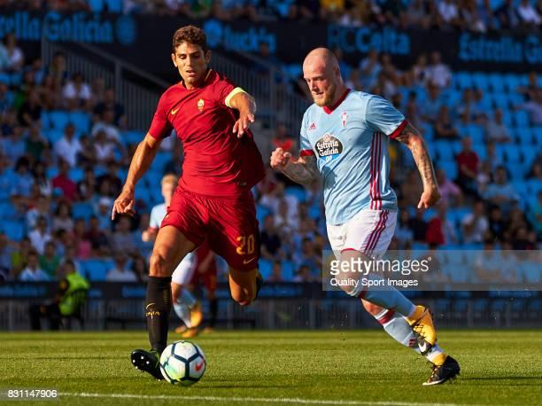 John Guidetti of Celta de Vigo competes for the ball with Federico Fazio of AS Roma during the preseason friendly match between Celta de Vigo and AS...