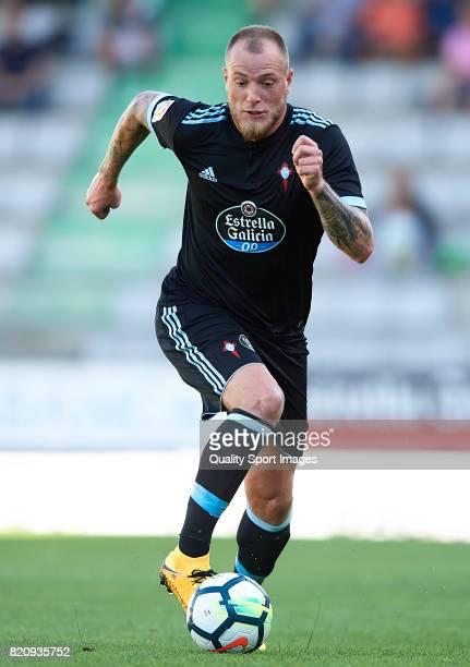 John Guidetti of Celta de Vigo runs with the ball during the preseason friendly match between Celta de Vigo and Sporting de Gijon at A Malata Stadium...