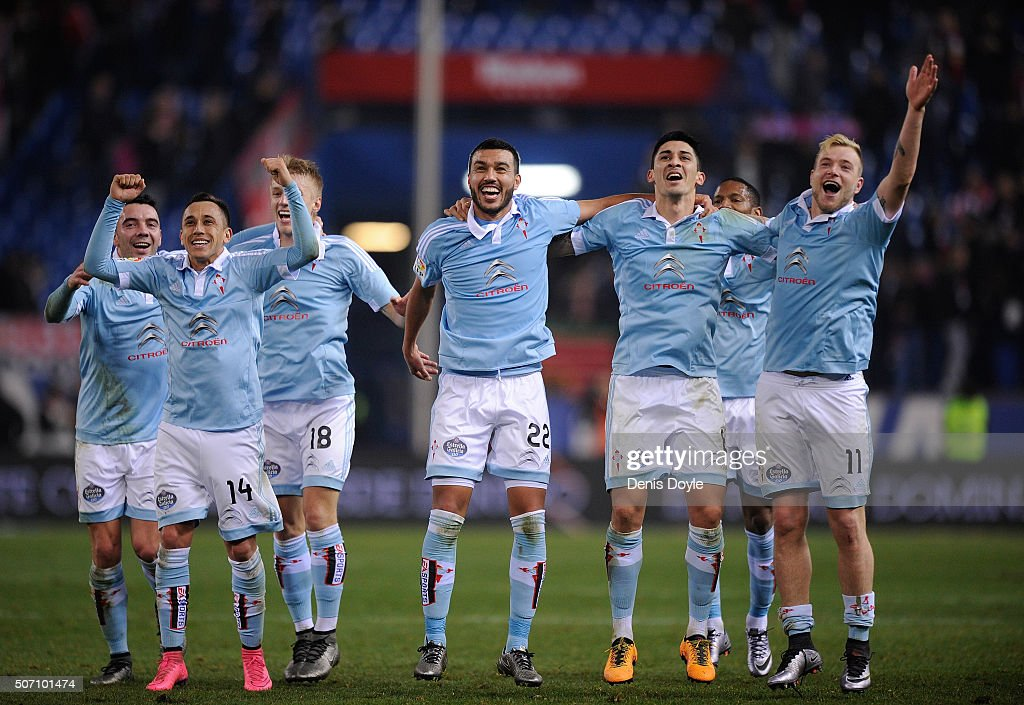John Guidetti (#11) of Celta Vigo celebrates with Fabian Orellana (#14) and Gustavo Cabral (#22) after Celta beat Club Atletico de Madrid 3-2 in the Copa del Rey Quarter Final 2nd Leg match at Vicente Calderon Stadium on January 27, 2016 in Madrid, Spain.
