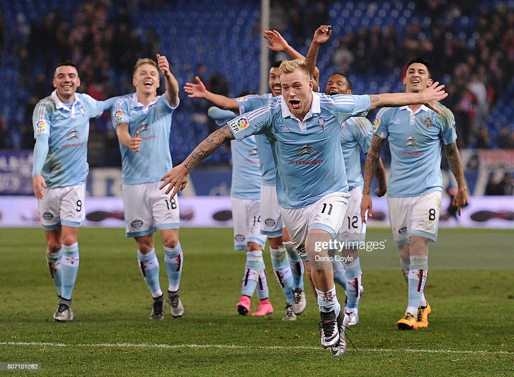John Guidetti of Celta Vigo celebrates with teammates after Celta beat Club Atletico de Madrid 3-2 during the Copa del Rey Quarter Final 2nd Leg match between Club Atletico de Madrid and Celta Vigo at Vicente Calderon Stadium on January 27, 2016 in Madrid, Spain.