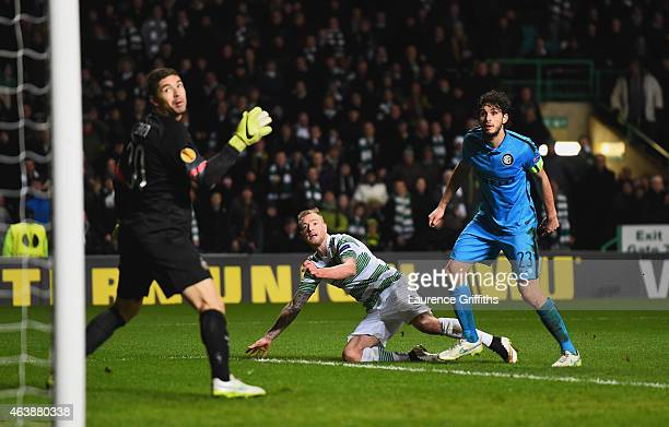 John Guidetti of Celtic looks on with Juan Pablo Carrizo and Andrea Ranocchia of Inter Milan as he scores the third and equalising goal during the...