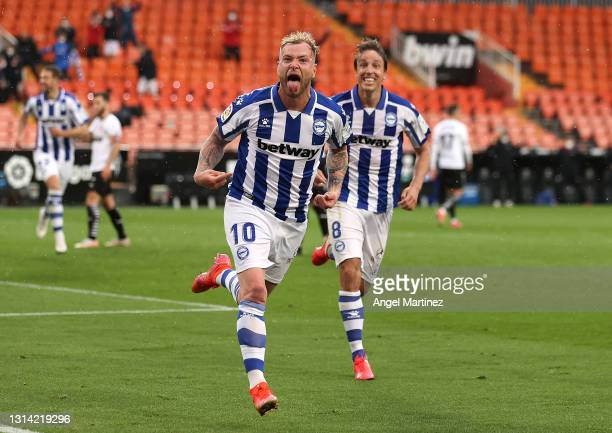 John Guidetti of Deportivo Alaves celebrates after scoring their sides first goal with team mate Tomas Pina during the La Liga Santander match...