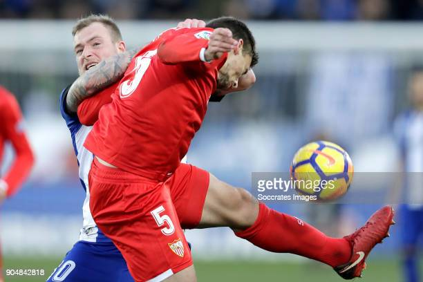 John Guidetti of Deportivo Alaves Clement Lenglet of Sevilla FC during the La Liga Santander match between Deportivo Alaves v Sevilla at the Estadio...