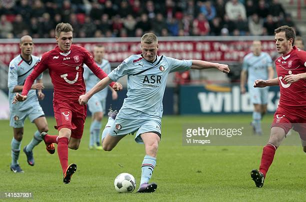 John Guidetti of Feyenoord kicks the ball against Wout Brama of FC Twente during the Dutch Eredivisie match between FC Twente and Feyenoord at the...