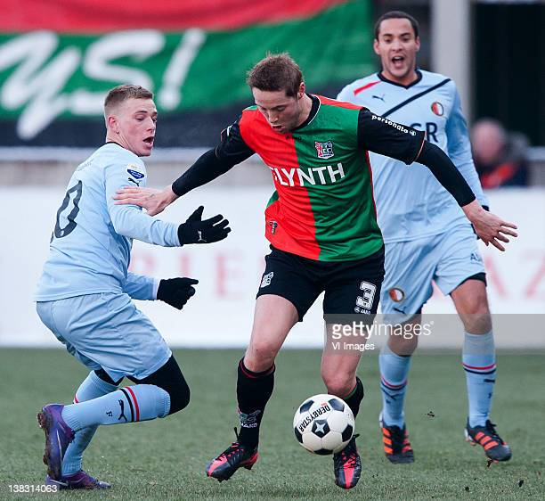 John Guidetti of Feyenoord Rens van Eijden of NEC Otman Bakkal of Feyenoord during the Dutch Eredivisie match between NEC Nijmegen and Feyenoord at...