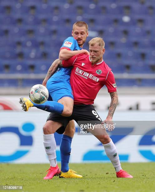 John Guidetti of Hannover 96 is challenged by Patrick Mainka of 1. FC Heidenheim 1846 during the Second Bundesliga match between Hannover 96 and 1....