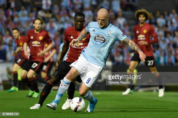 John Guidetti of RC Celta in action against Eric Bailly of Manchester United during the UEFA Europa League semi final first leg match between Celta...