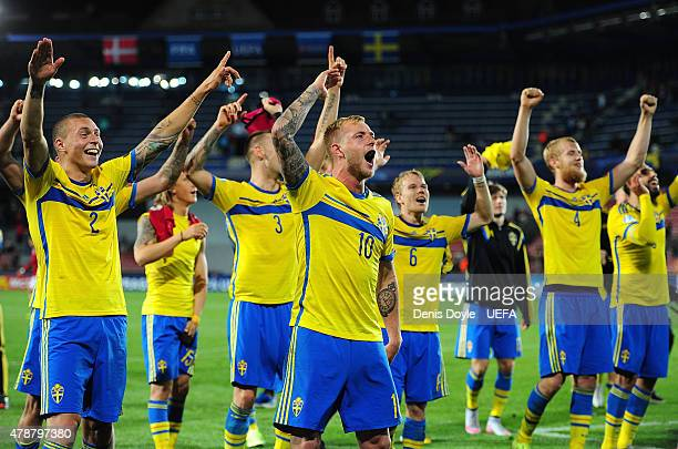 John Guidetti of Sweden celebrates with teammates after Sweden beat Denmark 41 during the UEFA Under 21 European Championship 2015 semifinal match...