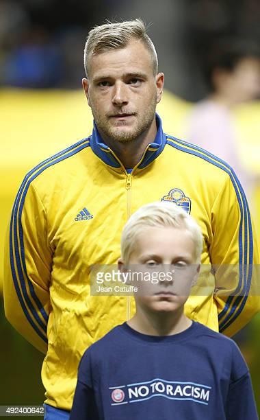 John Guidetti of Sweden stands during anthems prior to the UEFA EURO 2016 qualifier match between Sweden and Moldova at Friends Arena on October 12...