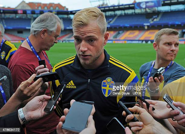 John Guidetti of Sweden talks to members of the press during the UEFA training session ahead of the UEFA European Championships semifinal match...