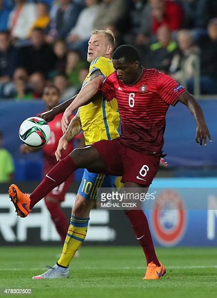 John Guidetti of Sweden vies for a ball with William Carvalho of Portugal during the UEFA Under21 European Championship 2015 group B match between...