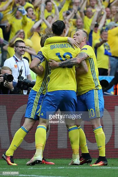 John Guidetti Zlatan Ibrahimovic and Kim Kallstrom of Sweden celebrate their team's first goal during the UEFA EURO 2016 Group E match between...