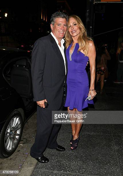 John H Bluher and Taylor Armstrong are seen outside the Avalon Theater on May 13 2015 in Los Angeles California