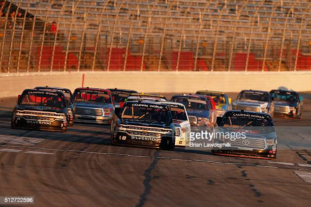 John H Nemechek driver of the farbe technik Chevrolet and Christopher Bell driver of the JBL Toyota lead the field during the NASCAR Camping World...
