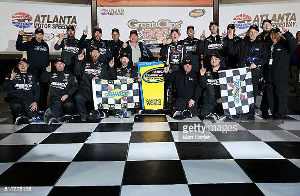 John H Nemechek driver of the farbe technik Chevrolet and his team pose for photos in Victory Lane after winning the NASCAR Camping World Truck...