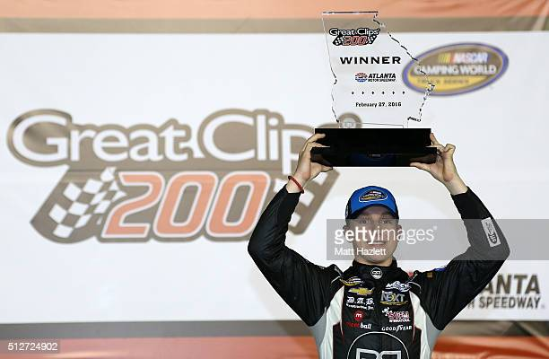 John H Nemechek driver of the farbe technik Chevrolet celebrates in Victory Lane after winning the NASCAR Camping World Truck Series Great Clips 200...
