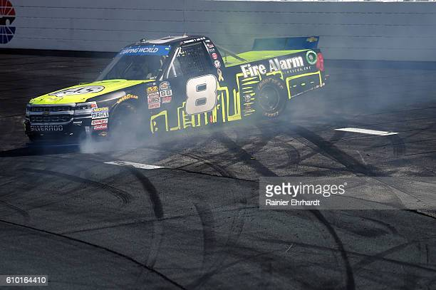John H Nemechek driver of the Fire Alarm Services Inc Chevrolet has an on track incident during the NASCAR Camping World Truck Series UNOH 175 at New...