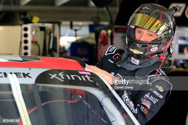 John H Nemechek driver of the Fire Alarm Services Inc Chevrolet climbs into his car during practice for the NASCAR Xfinity Series Rinnai 250 at...