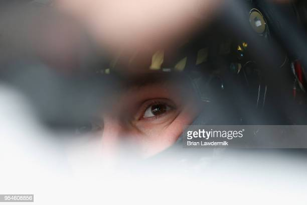 John H Nemechek driver of the Fire Alarm Services Inc Chevrolet sits in his car during practice for the NASCAR Xfinity Series OneMain Financial 200...