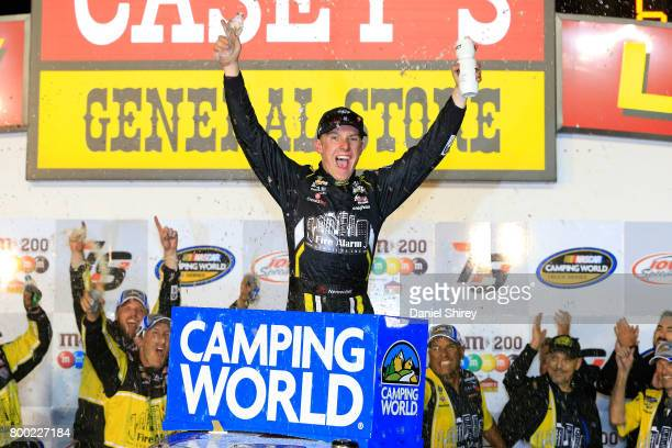 John H Nemechek driver of the FireAlarmServiceInc/RomcoEquipmentCo Chevrolet celebrates in Victory Lane after winning the NASCAR Camping World Trucks...