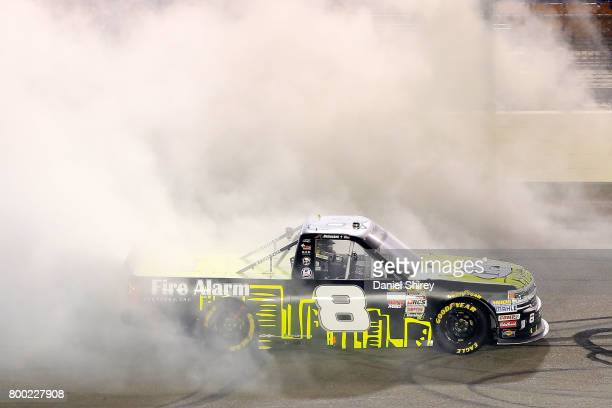 John H Nemechek driver of the FireAlarmServiceInc/RomcoEquipmentCo Chevrolet celebrates with a burnout after winning the NASCAR Camping World Trucks...