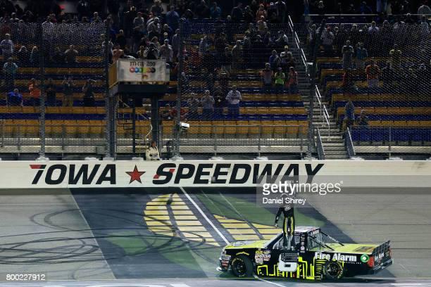 John H Nemechek driver of the FireAlarmServiceInc/RomcoEquipmentCo Chevrolet celebrates winning the NASCAR Camping World Trucks Series MMs 200 at...