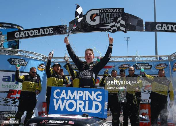 John H Nemechek driver of the Fleetwing Chevrolet celebrates in Victory Lane after winning the weather delayed NASCAR Camping World Truck Series...