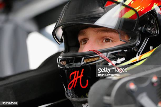 John H Nemechek driver of the Fleetwing Chevrolet sits in his truck during qualifying for the NASCAR Camping World Truck Series Alpha Energy...