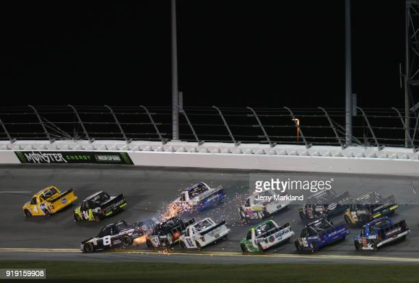 John H Nemechek driver of the Fleetwing Corporation Chevrolet wrecks during the NASCAR Camping World Truck Series NextEra Energy Resources 250 at...