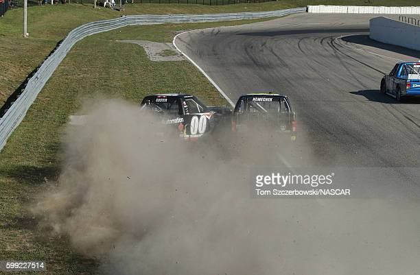 John H Nemechek driver of the NEMCO Motorsports Chevrolet crashes into Cole Custer driver of the Haas Automation Chevrolet as they cross the finish...